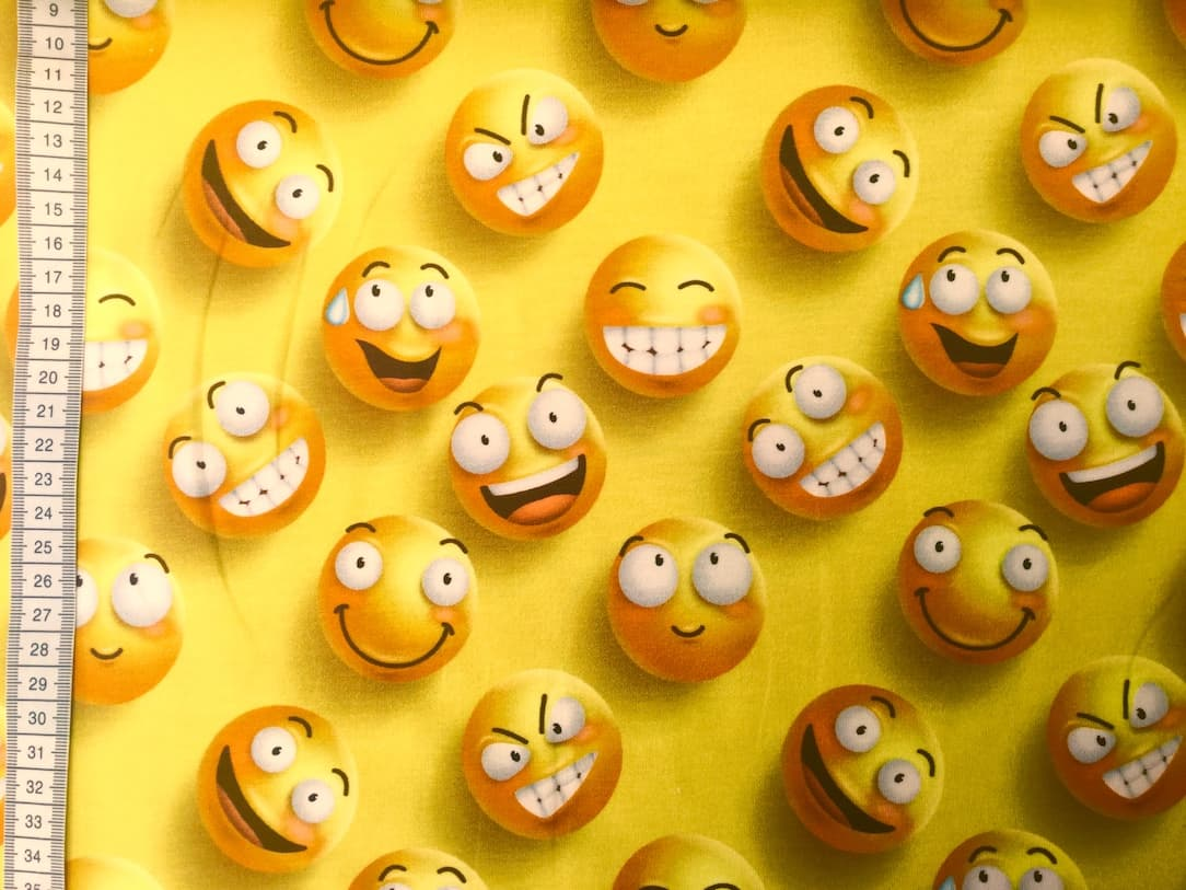 Jersey print med store smileys (gul)
